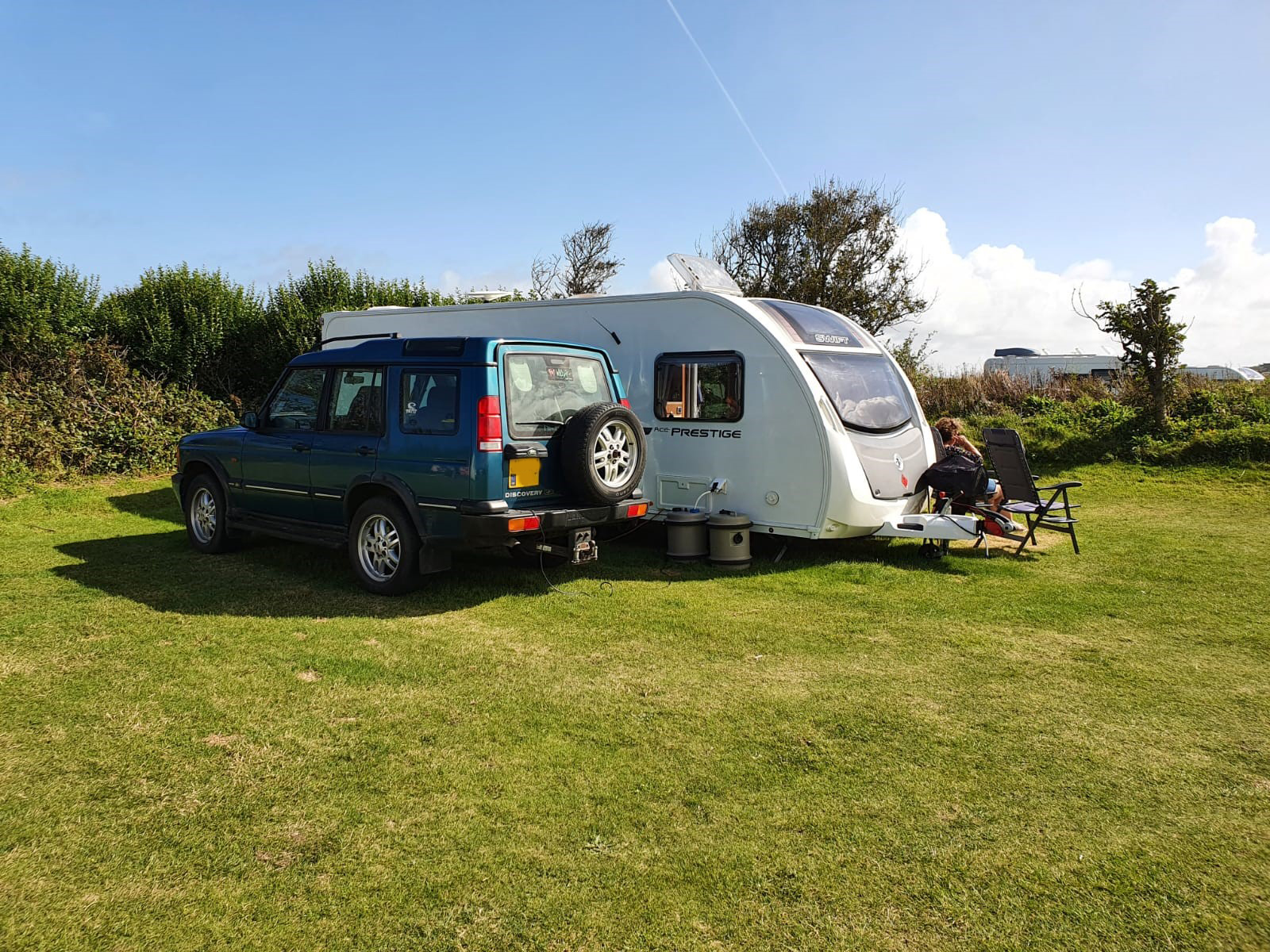relaxing with touring caravan after caravan body repair